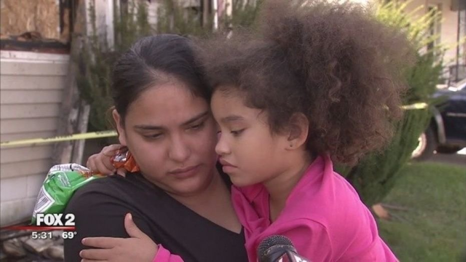 Rosa Conley with her daughter, Jamirah, who saved the family from a fire.  (FOX2)