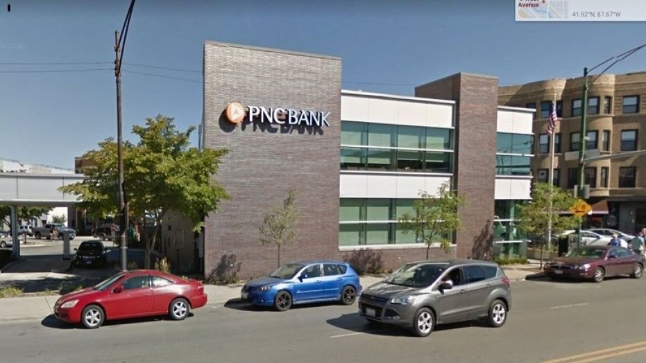 A Chicago woman died a few days after she was discovered unresponsive with her stuck in fence near a PNC Bank branch.  (Google Earth images)
