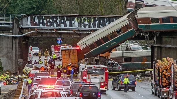 Speeding train falls off overpass in Washington state, killing three