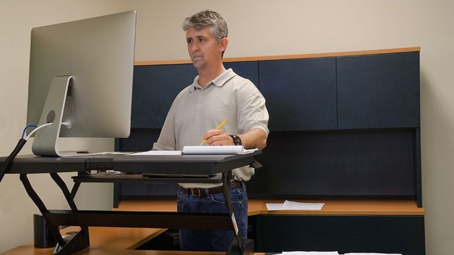 Standing desks may lead to back pain, brain drain