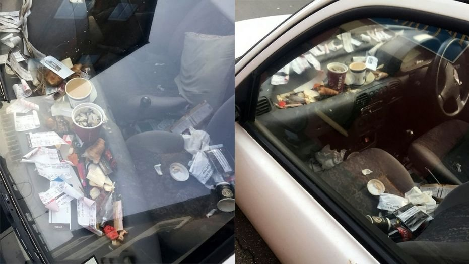 A Domino's delivery driver was suspended after photos of his messy car were sent to the pizza chain.  (SWNS)