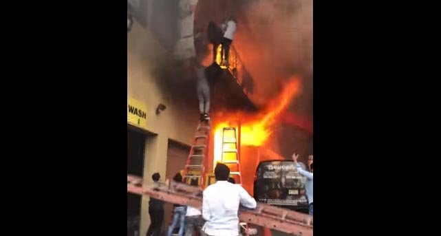 Video captures girls jumping off balcony to escape fire